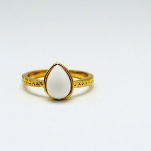 White acrylic pear shape stone in gold tone ring